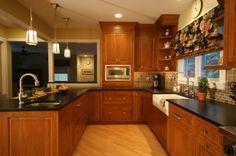 med cabinets. light floor. dark countertop.