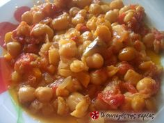 Chickpeas cooked in an earthenware lidded casserole dish