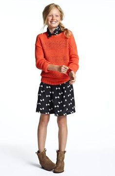 Sweater over classic dress. Love the color combo....