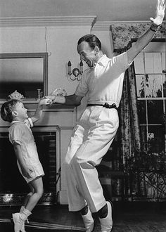 A heartwarming photo of Fred Astaire dancing with his son Fred Astaire Junior. #vintage #actors #dancers #father