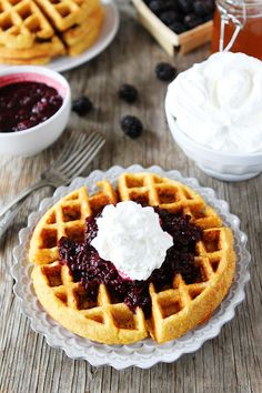 Cornmeal Waffles with Blackberry Compote Recipe on twopeasandtheirpod.com. These waffles are a favorite at our house!