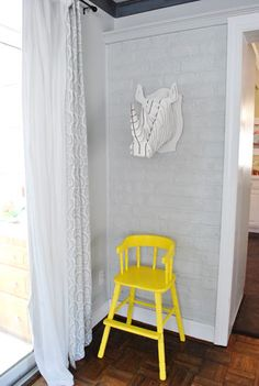 yellow kids chair+wall art