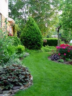 Reduce lawn size with low-care mixed gardens,  and keep the remaining lawn space weed-free  for a look that's both neat and colorful.