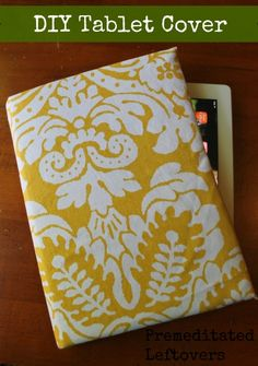 DIY Kindle or Tablet Cover Tutorial - Create a unique cover for your Kindle or tablet in less than 30 minutes using an old book, fabric, batting, and glue.