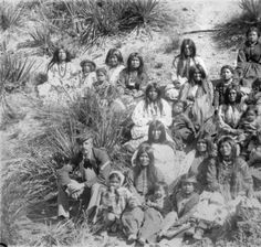 Group of Apache prisoners / prisoners on their own land. many would be sent off to Florida where very many died.