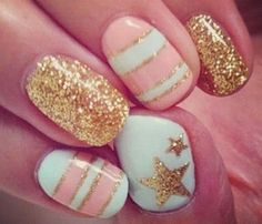 Glam Glitter Nails: Twinkle Twinkle Little Star. Shake things up by painting each nail a different design. All over glitter on one, stripes on another, and celestial details on the others. #SelfMagazine