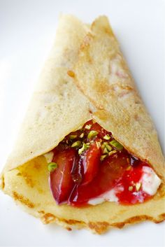 CosmoCookie: Honey Crepes with Black Plums, Mascarpone, and Pistachios