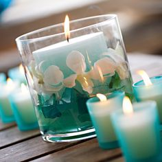 Turquoise candle with white orchids wedding decor centerpiece #turquoise #turquoisewedding #weddingdecor #diywedding #centerpiece