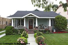 Bungalow  green/blue/grey with black and white trim.