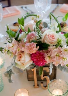 Pink and peach centerpiece- beautiful! Photo by Robin Nathan Photography, via http://theeverylastdetail.com/modern-elegant-peach-navy-maine-wedding/