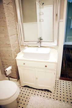 oversize mirror in small bathroom