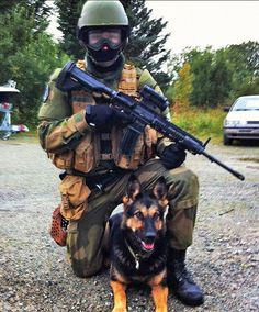 """Here's something you don't see every day: a soldier dog for the Norwegian military! This beauty's name is Norma. Handler Mikkel Bugge sent us this pic of the two of them because """"I am very proud of my dog and the duty she serves. She has been a soldier dog since she was born, and i just wanted to share the picture so Norma could get some notice for the work and training she does for the Norwegian military."""""""