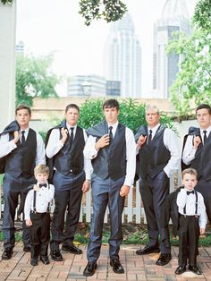 Jacket slung over the shoulder with groomsmen and potentially ring bearer.
