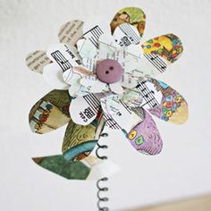 These flowers were handmade from recycled bed springs, children book pages, sheet music and dictionary pages, its unbelievable!
