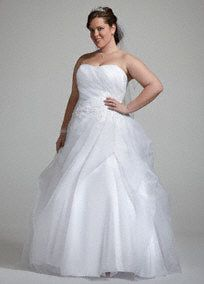 Dramatic, sensational and ultra-flattering are just a few words to describe this beautiful ball gown!  Strapless organza gown features stunning ruched detail creating a beautiful silhouette.  Beaded embroidered on the bodice combined with the full ball gown skirt create a classic and romantic look.  Sweep train. Available in White.  Fully lined. Back zip. Imported polyester. Dry clean.