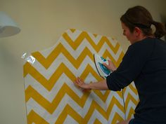 Applying fabric to a wall with starch. It can easily be removed when you move.