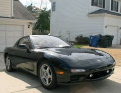 This 1993 Mazda RX-7 (VIN JM1FD3313P0203107) is described as an all-original, one-owner, 113k-mile example with the touring package and manu...