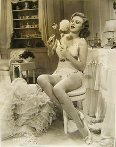 Ginger Rogers  powdering her face. :)