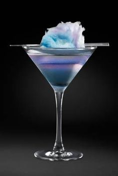 Cotton Candy Swirl. #recipe  Cotton candy vodka, St-Germain, cranberry juice, garnish with cotton candy. YUM!