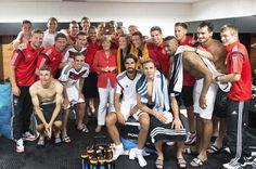 German Chancellor Angela Merkel with German World Cup winners 2014