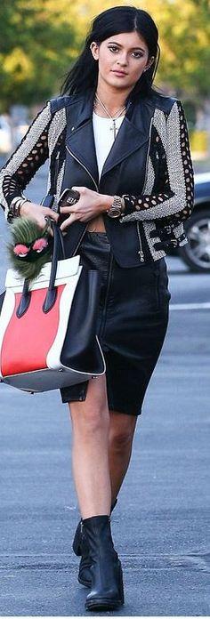 Kylie Jenner: Jacket – Yigal Azrouel  Purse – Celine  Skirt – Balmain  Shoes – Ann Demeulemeester