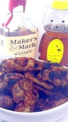 Honey Bourbon Sriracha Sauced Fried Grilled Chicken Wings... Th perfect wing... hints of Asian flavors with the beloved Sriracha HOT Sauce, cooling sweet honey and bourbon to bring out the Earthy savory flavors! THE ULTIMATE WINGS for any SUPER party