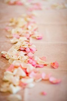 Rose petals were laid across the sandy aisle at this beach wedding in Mexico! So romantic. {Venue: Maroma Chapel, Photo: Elizabeth Medina Photography}