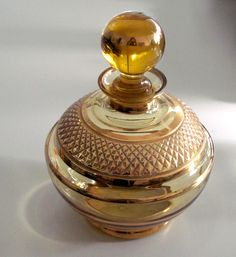 Art Deco lead crystal perfume bottle, amber colour with gold rims, 1930s,