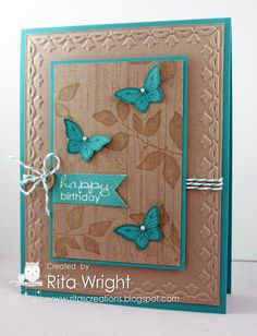 handmade card from Rita's Creations: kraft with turquoise mats and embellisments ... great Southwestern color combo ... like the double framed look  ... tulip embossing folder frame on main panel ... matting and popping up on the smaller panel ...kluv the tone on tone stamping on the main panel ... wood grain and delicate leaves ... lovely card! .. Stampin' Up!