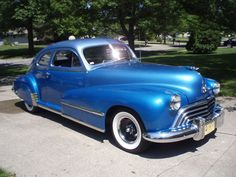 1948 bright blue Oldsmobile Club Coupe.