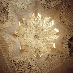 An ornate carved plaster cupula in the Alhambra in Granada