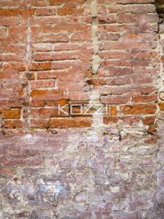 ancient brick wall. - Close-up shot of a ancient weathered brick wall in Tuscany.