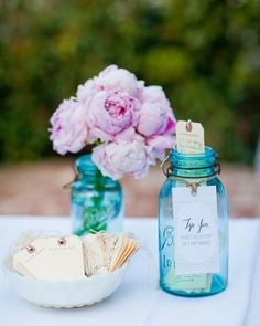 """Marriage Tip Jar  My favorite DIY project was our guest book, which we called a """"tip jar."""" I sourced some old mason jars and used shipping tags, which I letter-pressed with my own design, for the guests to fill out their """"tips for a happy marriage."""" We received some tips stating, """"Don't let the dogs slip between you in bed,"""" and """"Tell each other you love one another every day."""" We keep our full tip jar on our mantle and go through it from time to time for a laugh. It's turned out to be the greatest conversation piece."""