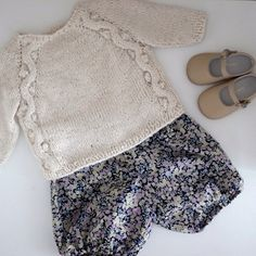 Knitted sweater and liberty print romper.