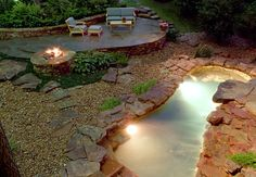 Flagstone patio with firepit and hot tub. <3