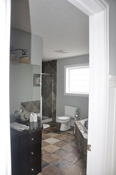 i'd love to paint our bath this blue... we already have the Indian slate and dark wood