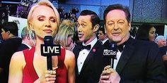 Joseph Gordon-Levitt photobombs commentators during the Oscars in Los Angeles, Cali. on Feb. 24, 2013 (themiddlefinger via Reddit, http://aka.ms/photobomb)
