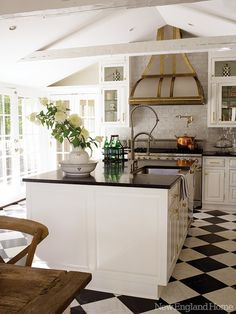 black and white kitchen tile. Gold accents & industrial faucet