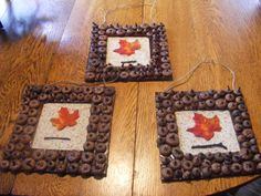 Paint a piece of card brown, glue of acorn caps. Spray with a sealant. Add burlap or a fall piece of cloth to the back. Glue on a silk leave, a small twig and a hanger. My day care parents loved it and many removed pictures from their wall to hang it up. very easy for young kids.