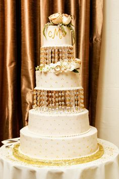 We are Loving this Amazing 4 Tier Cake - George Street Photo & Video #aldencastle #modernvintage #weddings #cake #whiteandgold