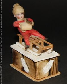 heubach candy container | Old Heubach Candy Container, red dressed Boy with a Muff on a wooden ...