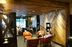 Our Lexington store has a rustic stable vibe featuring reclaimed barn wood celebrating Kentucky's rich equestrian heritage. coffe shop, reclaimed barn wood