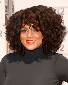 Marsha Ambrosius stepped out at the BET Awards wearing a voluminous batch of textured Shirley Temple curls. To create spirals like Marsha's at home, pick up a few packs of flexirods which are great for creating curls on natural hair. Staring with medium-sized, slightly damp sections, roll the rods tight starting at the roots of the hair which will elongate your curls and create fullness.