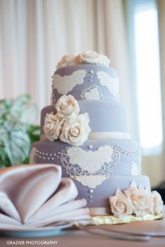 Purple wedding cake with lace decorations: http://www.stylemepretty.com/little-black-book-blog/2014/10/22/charlene-and-max-newport-estate-wedding/   Photography: Grazier Photography - http://www.grazierphotography.com/