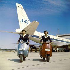 stewardesses on vespas