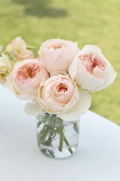 english roses, pink roses, pink flowers, flower centerpieces, pale pink, wedding flowers, mason jars, garden, pink peonies