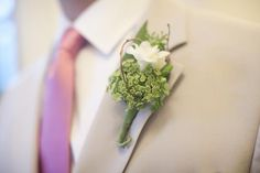 #boutonniere featuring freesia, Queen Ann's lace and curly willow accent