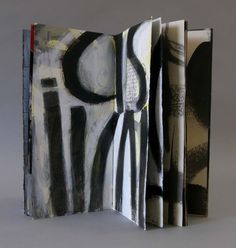 Laura Wait Imminent Struggle painted pages in book.