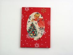 Christmas Tree - A beautiful and versatile folded card made from the highest quality colored card. Its pure solid colour flows through it's surface which features a crisp, original smooth finish. Card is decorated with designer vintage printed fabric and the finishing touch: printed cellophane. It comes with poppy red envelope in protective cellobag.