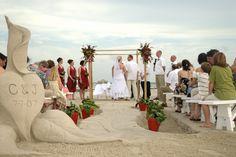 Do use the sand as part of your beach wedding decor.